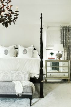 ML Interior Design: Gorgeous bedroom with glossy black French poster bed with white and black monogrammed ...