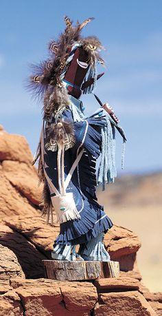 Kokopelli Kachina Doll The Kokopelli is the ancient Anasazi symbol of the humpbacked, minor god flute player. His main task is to provide abundance, fertility and rainmaking!