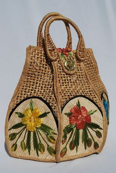 Vintage 60's hand waved basket purse bucket bag raffia floral design hand made in PHILIPPINES by thekaliman. $60.00, via Etsy.
