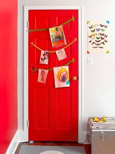 <p>After we covered the back of the door with some of the leftover berry-pink paint, we realized it would be a lovely place to show off the girls' masterpieces. So we used washi tape to hang some lengths of pom-pom and rickrack trim, then added a few mini clothespins for clipping their work.</p>                 <p><i>Originally published in the May 2014 issue of</i> FamilyFun <i>magazine.</i></p>