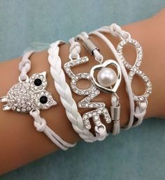 Shop Women's Fashion White Silver size OS Bracelets at a discounted price at Poshmark. Description: Rhinestone Cord Owl Bracelet Feature the beautiful infinity, owl, love, and heart. Cheap Fashion Jewelry, Fashion Jewelry Necklaces, Fashion Bracelets, Fashion Ring, Fashion Accessories, Diy Leather Bracelet, Owl Bracelet, Bracelet Men, Pearl Bracelet