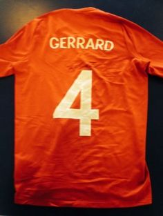 Signed England football shirt by Gerrard.