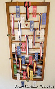 an old crib railing becomes a great place to display ribbons and hide an ugly wall, repurposing upcycling, wall decor, Cover an ugly wall vent get creative by using an old crib railing to display award ribbons Diy Home Crafts, Diy Home Decor, Room Decor, Wall Decor, Crib Spring, Award Display, Trophy Display, Display Ideas, Ribbon Display