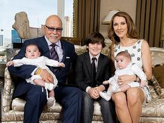 Celine Dion with her husband Rene Angelil and sons Rene-Charles (RC), Nelson, and Eddy.