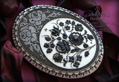 Some intricate royal icing technique, what awesome on cookie and on cake too. It's a larger piece, 22 cm high. I didn't use tips, only hands folded cone shaped foil bag. It's nose is thinner than everything. Black on white roses pattern is...