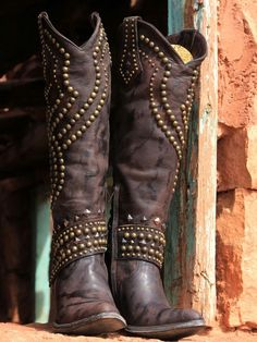 ~  The Belinda Boot.  Taller than most cowgirl boots, I love the nail head studs on the shaft and at the knee.  Its unique design allows it to be dressed up or down; working equally well with jeans, skirts and leather pants. ~