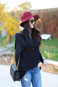 A wide-brim fedora makes a statement against simple tees and sweater dresses. Opt for a jewel tone to finish a fall outfit. #FallFashion #Fedora