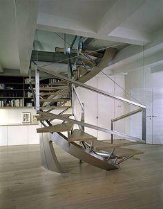Escada ultra-moderna, com geometria e ângulos.