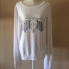 NWOT Wildfox Bullhead Jumper White Size Large New without tags (they fell off) Wildfox Couture White Bullhead Baggy Beach Jumper with feathers hanging from the horns, and a crescent moon above the skull. Size Large. No stains/holes etc.   Please ask any questions you may have prior to purchasing   ✨✨No Trades✨✨ Wildfox Sweaters