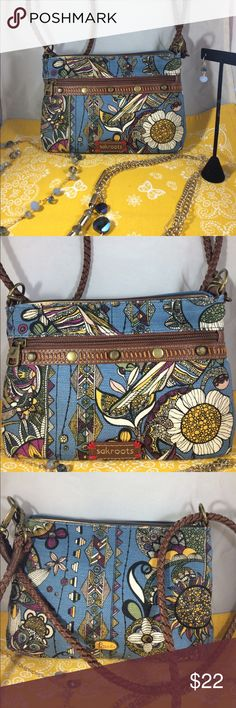 Sakroots blue owl and flower purse  This adorable small Salroots purse is just about too cute for words!  the fabric is like a printed canvas and it has a woven convertible strap which will allow it to be worn on the shoulder or as a cross over. GREAT little bag!!! GET IT TODAY!!!! No tags but appears brand new! The Sak Bags Crossbody Bags