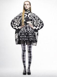 It's like black and white snakes took over this sweater. Sachio Kawasaki.