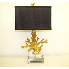 @Overstock.com - Golden Coral Table Lamp - This golden coral table lamp with black shade will provide light and art to any room. Made of brass, crystal, and gold, this lamp is exquisite. Place on a nightstand in your master suite, or use for accent lighting in an office or living room.  http://www.overstock.com/Home-Garden/Golden-Coral-Table-Lamp/5703944/product.html?CID=214117 $180.99
