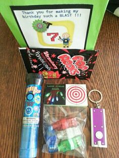 Laser tag birthday : favor bags --> pop rocks, flashlight keychain, finger beams, laser pop candy.