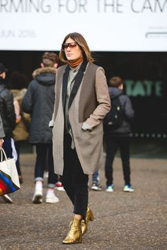 The Best Street Style At LFW AW16 #refinery29  http://www.refinery29.uk/2016/02/103500/street-style-london-fashion-week-aw16-news#slide-54  Glamour UK's Fashion Director Natalie Hartley rocks the classic fashion-hair-tuck-into-polo a la Phoebe Philo....