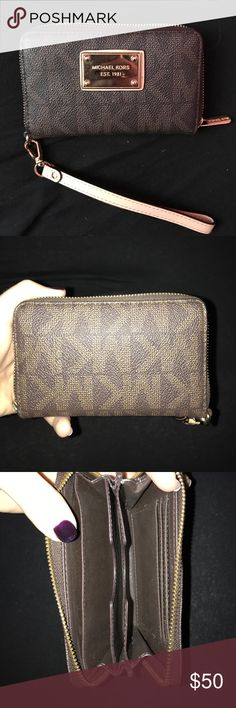 Michael Kors Brown Logo Wristlet Wallet Clutch Zip Gently used 100% authentic Michael Kors small jet set logo zippered wallet / wrislet. In excellent condition inside and out. Detachable wrist strip which shows Zero signs of use. Only thing is slight scratching to the front metal logo. Interior in excellent condition. Zipper works perfectly. Make me an offer! Michael Kors Bags Wallets