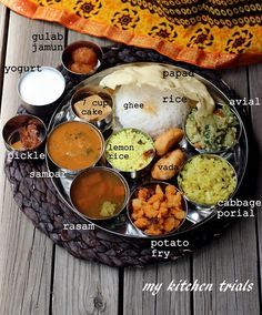 Thali – My Kitchen Trials. A typical South Indian Tamil Nadu meals consist of rice, served with a lentil based gravy like sambar with vegetables on the side. Yogurt is an essential part of the meal.