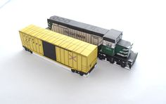 """My American Freight Train in Green with a """"Trakbox"""" boxcar! The """"Freighttrain"""" livery is inspired by assets created by the steam user Bsquiklehausen for Cities: Skylines. If you play, check out his stuff!"""