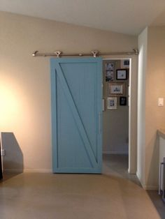 sliding barn door by Woodlandsfurniture on Etsy, $1200.00