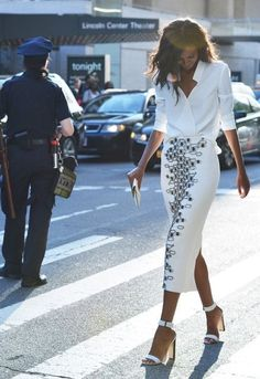 White blouse and skirt, and high heel shoes. Model walking down the street. FROM: CARTE BLANCHE