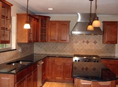 Black Galaxy Granite Countertop with different wood color from cabinets to floor.