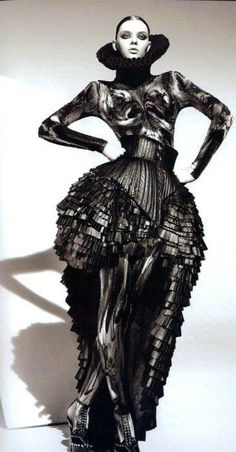 Sculptural Fashion - dramatic dress; voluminous silhouette and a luxurious mix of textures & pattern detail; dark fashion