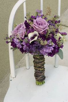 Lavender roses and purple stock. Light and dark contrast.-To find more wedding planning tips, DIY, dress ideas and more