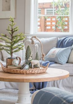 Tour a warm and cozy living room decorated for Christmas. Neutral furnishings with pops of blue, natural evergreens, and vintage and thrifted finds. Winter Living Room, Christmas Living Rooms, Cottage Christmas, Cozy Living Rooms, Cozy Christmas, Living Room Interior, Living Room Decor, Christmas Crafts, Christmas Decorations