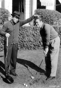 Bing Crosby and Bob Hope relaxing with golf.