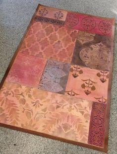 "Use stencils from our Ethnic collection to create this ""Global Carpet Collage"" with texture, Stencil Cremes, and stains. Shown on floor-but it's for a wall hanging."
