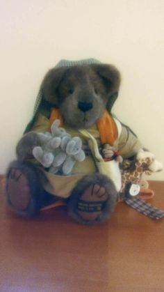 All he needs is his ark! Sweet Mr. Noah, a Boyds Bear limited edition and retired bear, with stunned if his two by two friends. Hes holding pairs of elephants, giraffes, and chimpanzees, along with a runner measuring one cubit. Fully jointed, hes dressed in a traditional gown and