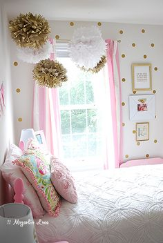 Pink, white, and gold girl's room with adorable tissue poms | 11 Magnolia Lane http://www.nashvillewrapscommunity.com/blog/2010/07/how-to-make-tissue-flower-pom-poms/