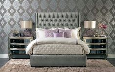 Gray tufted bed with lavender throw pillows.