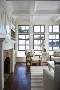 Gorgeous coffered ceiling, lovely wooden floor and great fireplace.  Love the windows and the view, too!