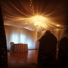 beautiful canopy and chandelier  over the bride and groom for their wedding vows/dance floor