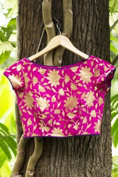 Buy Fuchsia Pink Brocade Blouse With Purple Edging online in India at best price.Did somebody say crop top with saree? Don this faux crop top in brocade designed with a princess cut Brocade Blouse Designs, Brocade Blouses, Designer Blouse Patterns, Blouse Neck Designs, Brocade Fabric, Sleeve Designs, Blouse Models, Beautiful Blouses, Beautiful Women