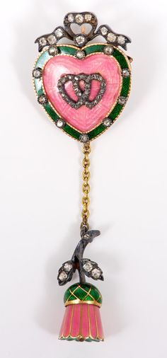 Fine Victorian diamond and enamel sweetheart pendant locket brooch.  The heart-shape plaque with two entwined diamond set hearts on a pink guilloche enamel ground with green enamel border set with diamonds.