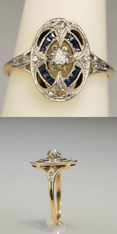Art Deco diamond and sapphire engagement ring, circa 1930. In 18k yellow gold with a platinum layer on the top. An European brilliant cut diamond centers in an intricate oval plaque enhanced by twelve calibrated sapphires channel set. The pierced panel is encrusted with four tiny rose cut diamonds, finished with open works, mille grained, the split shoulders are encrusted with one rose cut diamond each. European. The top panel 1.4 x 1 cm (0.55 x 0.39 inch).