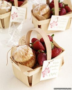 Send wedding guests home with fresh strawberries and scones to enjoy the morning after. Wrap scones in cellophane, and line a wooden berry basket with parchment paper. Tie on a note stamped with a strawberry design