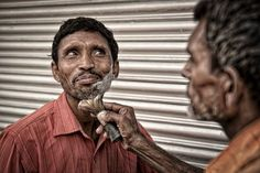 Shaver in Old Delhi Photo by Benoit Briand — National Geographic Your Shot