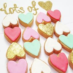 'Lots of Love' cookie setIncludes 16 mini heart cookies decorated in mint, coral, white, pink and gold glitter. Our Vanilla Sugar Cookies are all made to order. They are handmade and decorated with royal icing.Cookie will be wrapped in cello with 'Lots of Love' Tag attached. Price INCLUDES Postage (Aust Wide). Cookies will be sent on Monday 4th May via EXPRESS Australia Post. Perfect little sweet treat to spoil someone special. Ingredients include:...