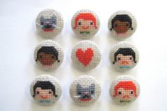 Cross stitch badges. I particularly like the cat with whiskers