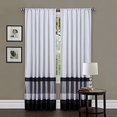 Lush Decor White/ Black 84-inch Iman Curtain Panel  Write a review  Today $34.99  Item #: 14120129        Decorate your home with this gorgeous window panel with faux silk construction. Rod pocket slides onto curtain rod for easy installation. ...more