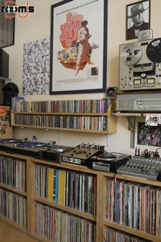 Ultimate Bedroom DJ. Turntables, mixer, cd's and other various audio equipment with of course...the record collection - by Mike Ungewitter.