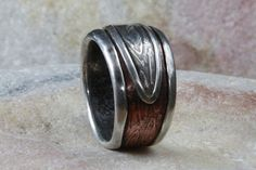 Rounded and smooth. Mans ring of sterling silver and copper. Mans engagement ring, wedding band on Etsy, $140.00