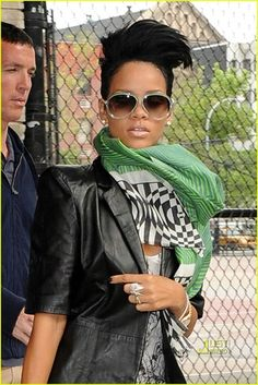 rihanna. here she looks gorgeous! i love the scarf and jacket combo, oh and the ring.