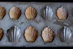 Bake the madeleines for 12 - 14 minutes (7-10 minutes for smaller cookies), or until the edges of the madeleines are golden brown. Remove from oven and unmold immediately. Cool on racks and dust with powdered sugar.