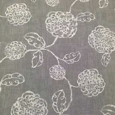 Magnolia Home Adele Slate is a 100% 6 ounce cotton duck fabric. It features a floral print in ivory on a slate gray background. The fabric is light to medium weight with a soft drape. It's suitable for light furniture upholstery, pillows, window treatments, tote bags, headboards, tablecloths, placemats, aprons and other crafts.