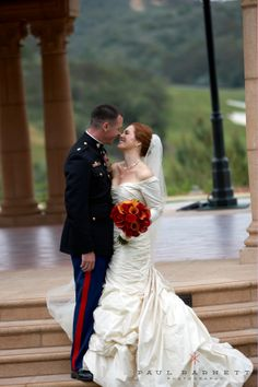 Beautiful redhead with her red rose bouquet and her handsome military husband at the Grand Del Mar. Luxury Wedding Photography, Paul Barnett Photographer