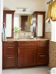 Use vertical space. Even if your bath is small, you still have some height to play with. Tall freestanding units add much needed storage. If you're remodeling, consider a cabinet that sits on the countertop.