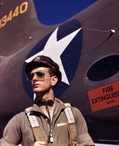 "October 1942. ""Lieutenant 'Mike' Hunter, Army test pilot assigned to Douglas Aircraft Company, Long Beach, California."" 4×5 Kodachrome transparency by Alfred Palmer for the Office of War Information."